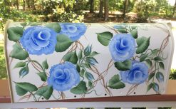 hand painted mailbox with blue roses on trellis background