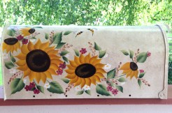 hand painted mailbox with sunflowers, bees and flowers on beige background
