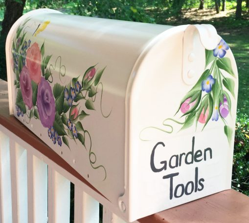 hand painted mailbox with colorful flowers roses and butterflies front side