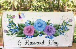 hand painted mailbox with fairies and variety of flowers