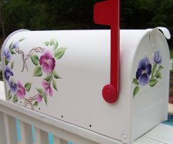 hand painted mailbox with a pansy heart wreath