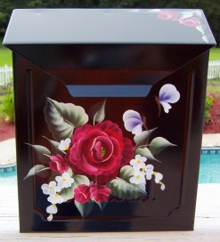 hand painted mailbox with red roses