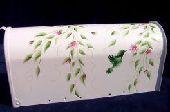 hand painted hummingbird mailbox with trailing rosebuds
