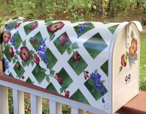 wild roses and purple flowers hand painted mailbox with lattice and deep green background
