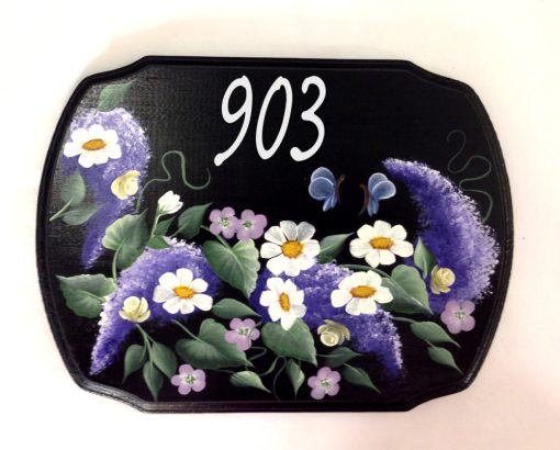 house address place with purple wisteria and daisies