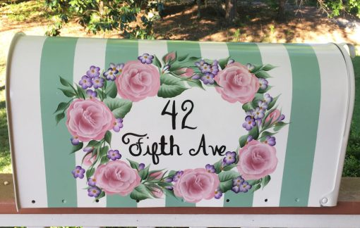 hand painted mailbox with a rose oval