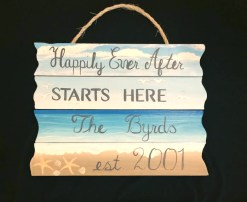 custom hand painted sign with happily every after and personalization on a beach scene