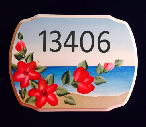 house numbers plaque with beach background and red hibiscus foreground