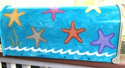 hand painted mailbox with ocean background and colorful starfish