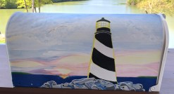 coastal light house hand painted mailbox in daylight