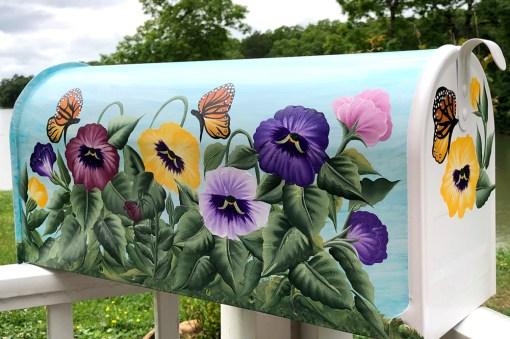 hand painted mailbox with color pansy flowers and butterflies