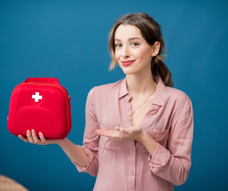 A bride to be holding her wedding day emergency kit.