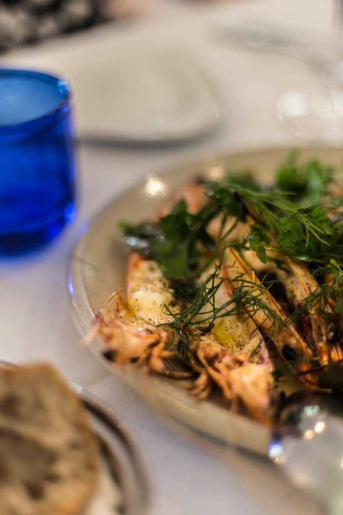 Cottonwood & Co - Grilled King prawns with brown butter, lemon, caper leaves & garden herbs at Bells at Killcare