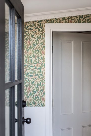 Cottage entry with William Morris Bird & Pomegranate wallpaper