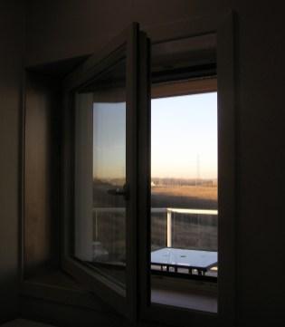 Tilt-n-turn window at dusk