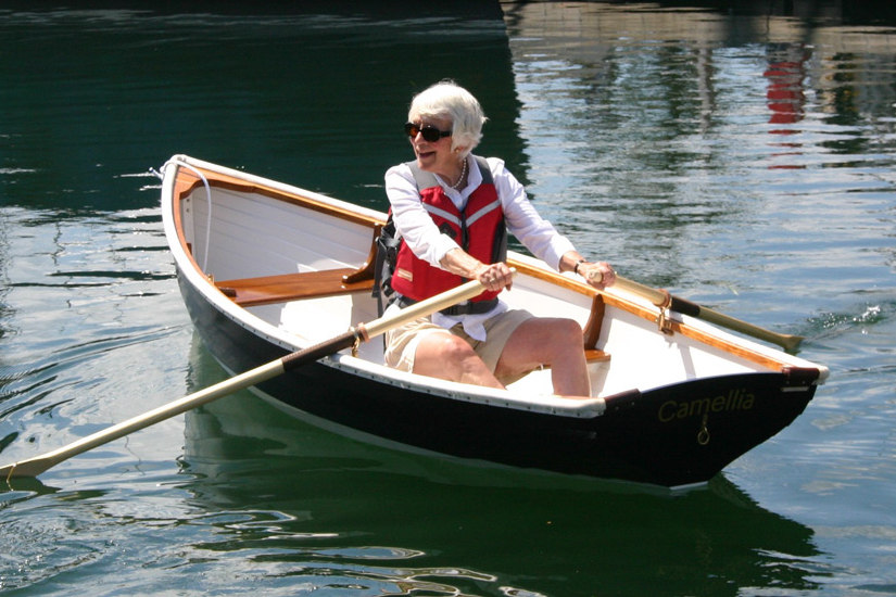 Mary rowing her Tadpole a Maine Whitehall