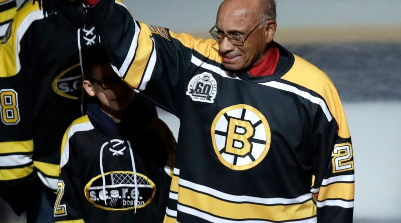 Willie O'Ree dropping the ceremonial first puck