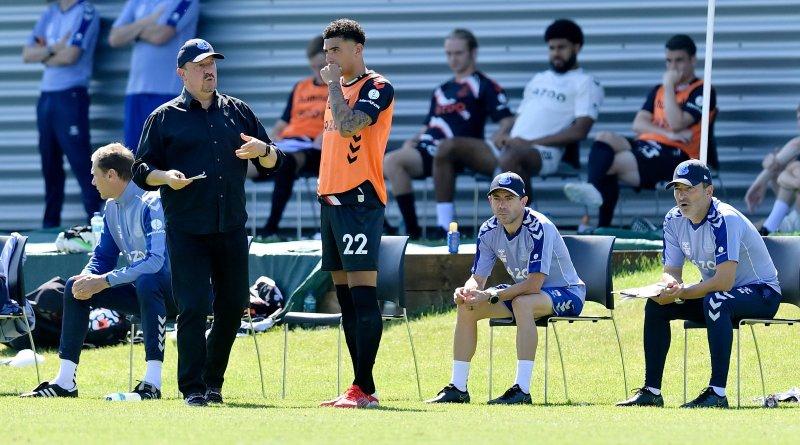 Everton manager Rafa Benítez speaks with CB Ben Godfrey during the club's pre-season practice match against Blackburn