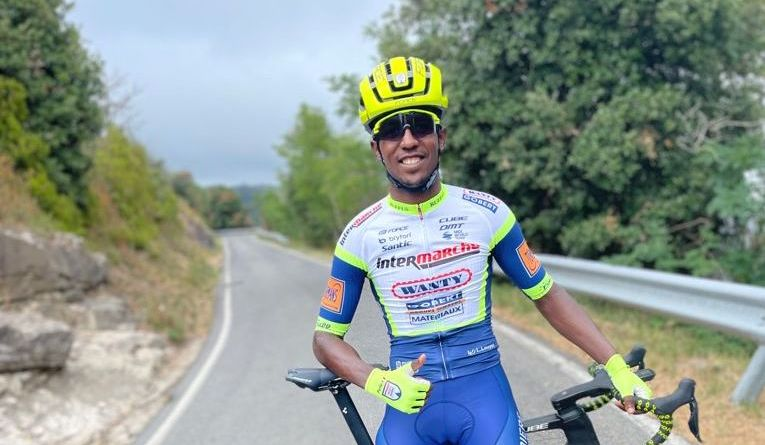 Biniam Girmay poses in the kit of his new team, Intermarché–Wanty–Gobert Matériaux