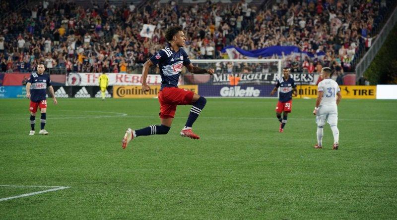 Tajon Buchanan celebrates in from of New England Revolution fans after a recent goal against FC Cincinnati