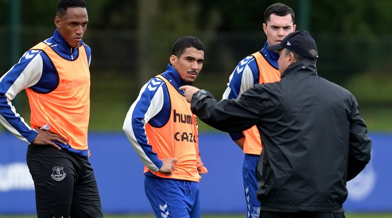 Everton players Yerry Mina, Allan and Michael Keane listen to instructions from manager Rafa Benitez ahead of Saturday's clash with Watford
