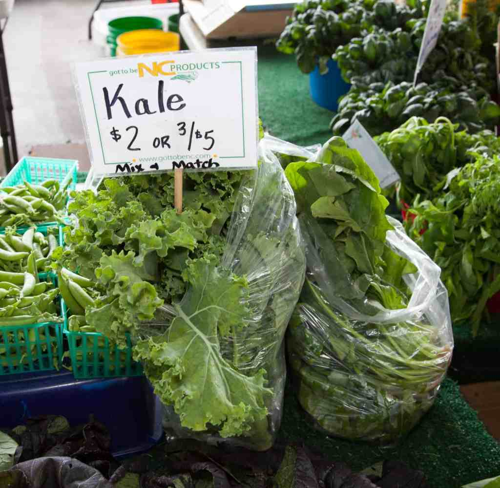 kale sold in bags at a farmer's market
