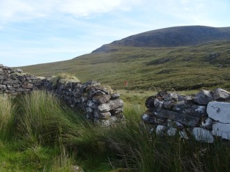 An old house, just inside the fence, next to the Kearvaig River, looking back towards Fashven