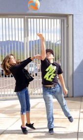 Seventh graders Brooklyn Garcia, left, and Brody Bullard try to hit the ball while playing volleyball during lunch. (This photo earned an Excellent rating for photographer SeAnna Brennan.)