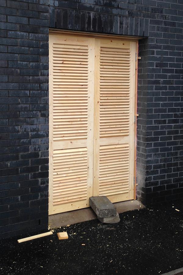Joiner handmade louvre doors onsite Manchester