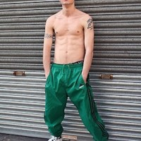 Green trackies trainers lad