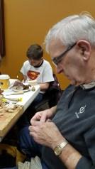 Glen Secor mentoring new woodcarver
