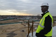 Joseph Byrd, a COTA member and site assistant for Wyandanch Rising, looks out on the land that will house the second apartment building.