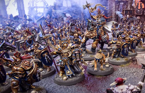 Age of Sigmar: Heavily armed Stormcast Ethernal Retributors models with shields and halbards.