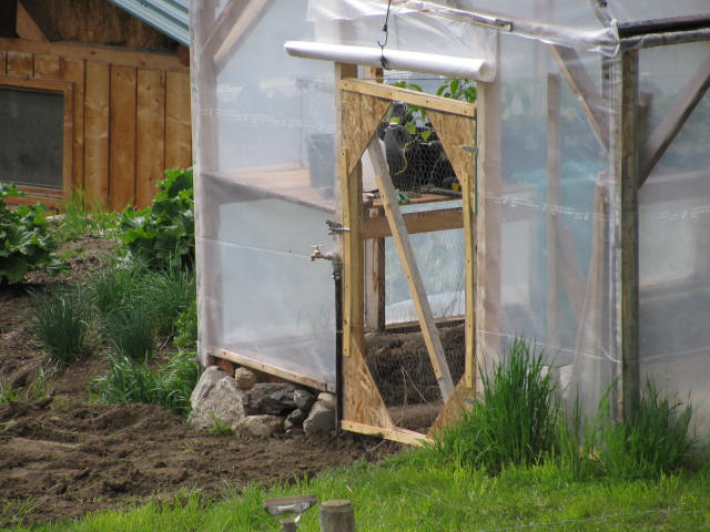 A new door made of chicken wire and wood