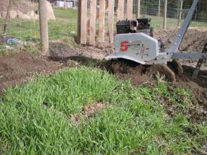 tilling garden, spring, country living in a cariboo valley