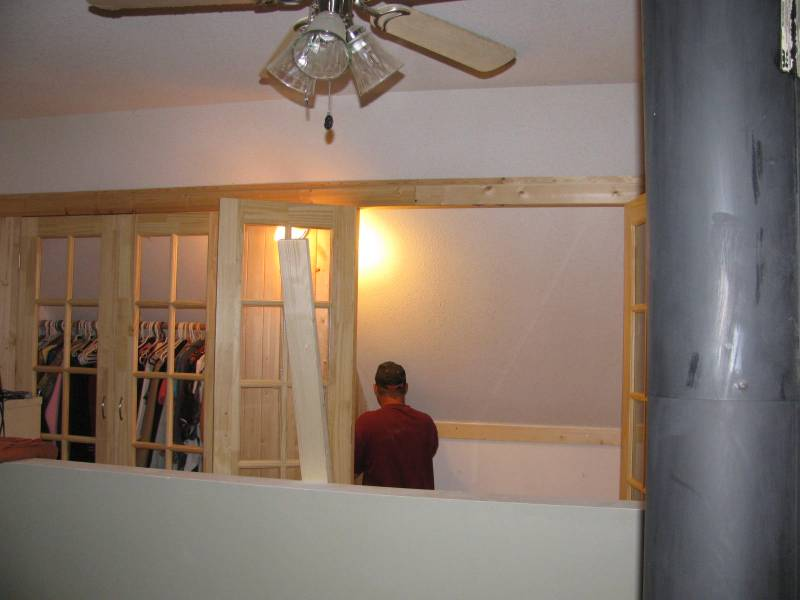 Attaching the back board in the loft closet