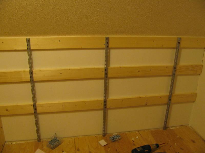 shelving tracks installed in closet