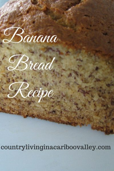 Close up of a sliced loaf of banana bread.