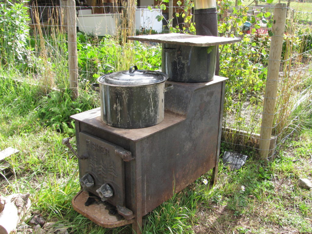 a woodstove cooking vegetables to feed farm animals