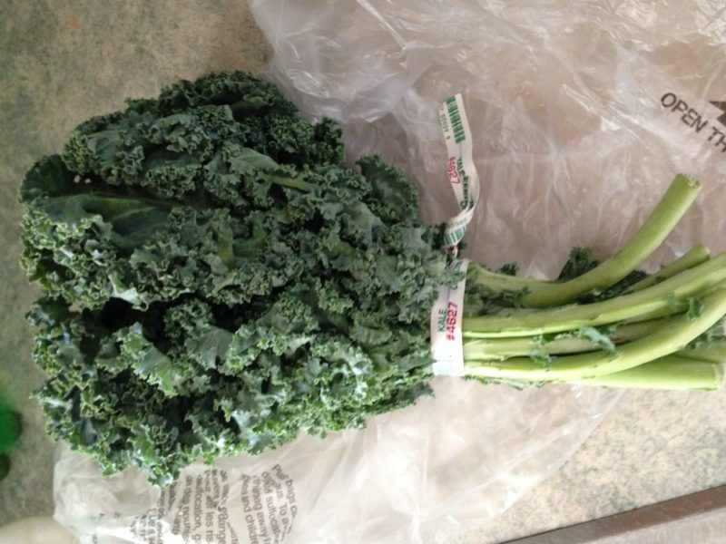 A bundle of kale on a counter.