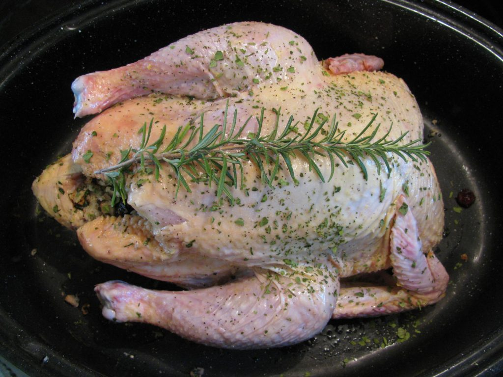 chicken stuffed and topped with Rosemary waiting to be oven roasted