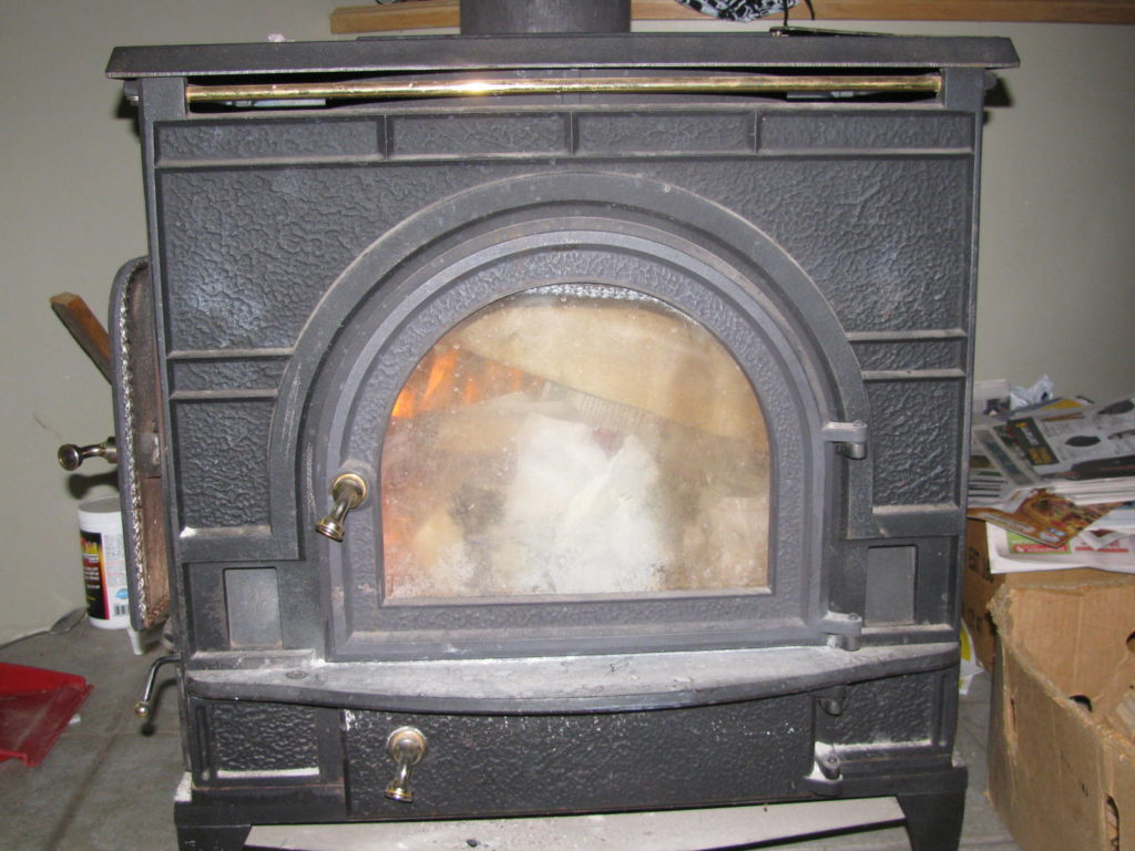 how to save money this month, heat with a woodstove, how to save money