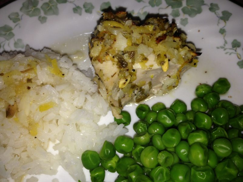 Lemon chicken with rice and peas.