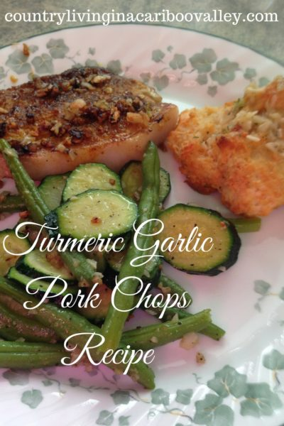 Turmeric Garlic Pork Chops alongside grilled vegetables.