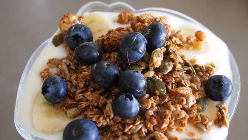Homemade granola with yogurt and blueberries.
