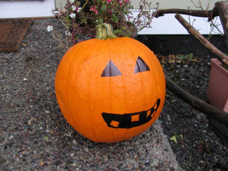 Pumpkin on a front porch.
