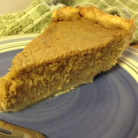 a slice of pumpkin pie sits on a plate