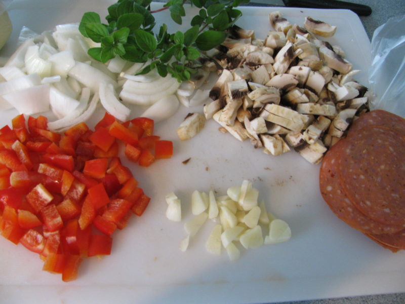 Diced tomatoes, onions, mushrooms, garlic, sausage and herbs.