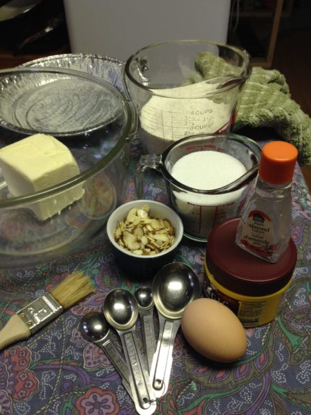 Ingredients and supplies for Boterkoek on a table.