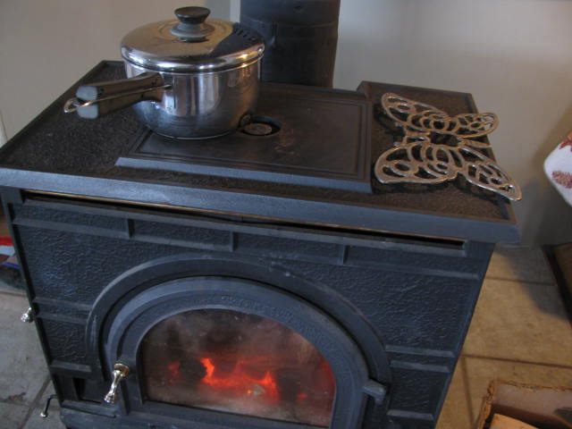 a pot simmering on the woodstove